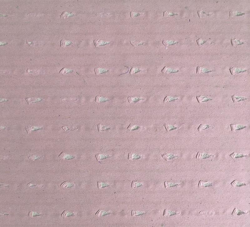 Rollo de papel perforado rosa separador colores tejidos en corte automatico